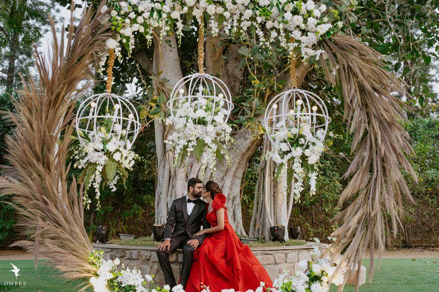 Photo of Cute couple portrait under a floral decor setup