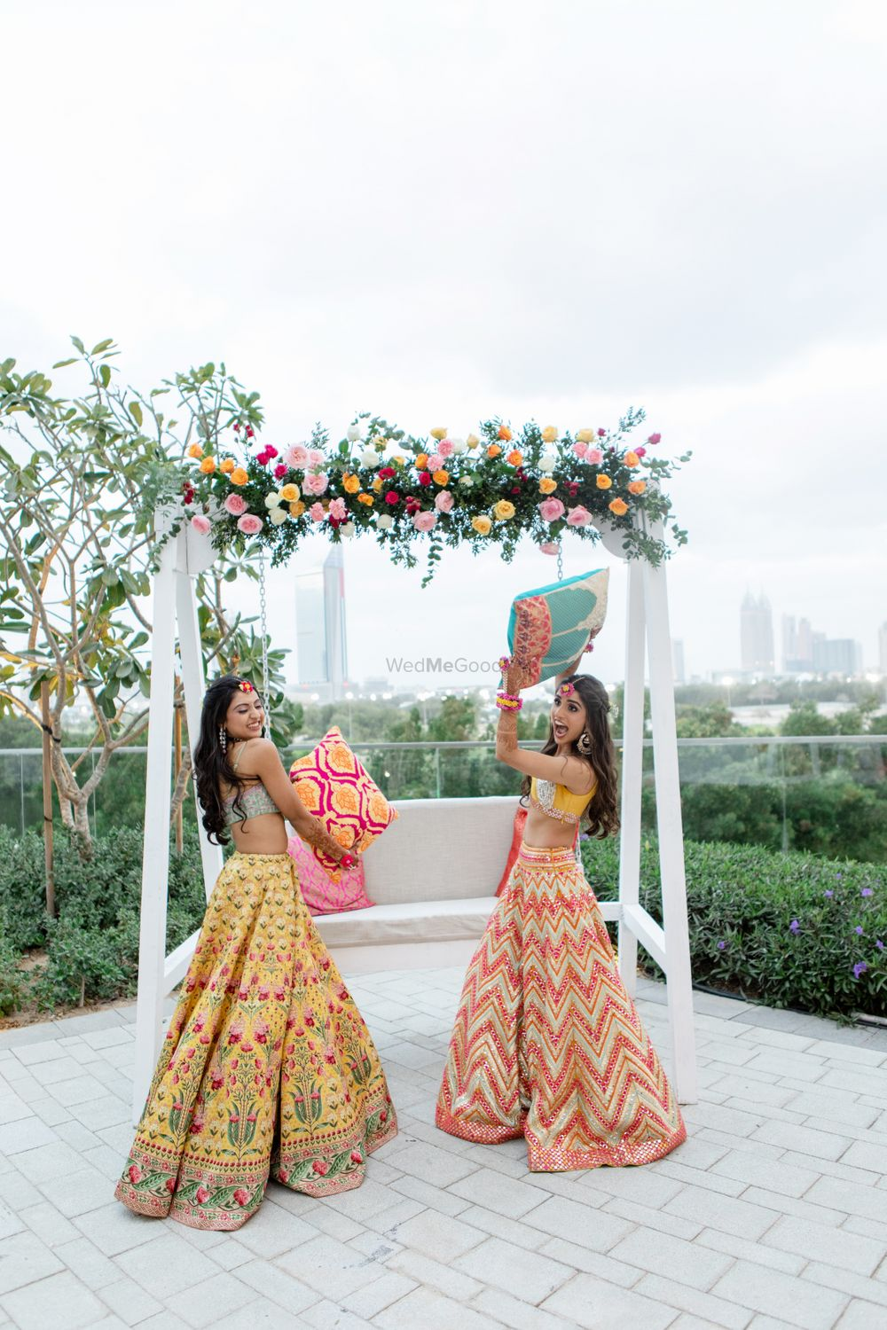 Photo of Candid shot of a bride and her sister having fun.