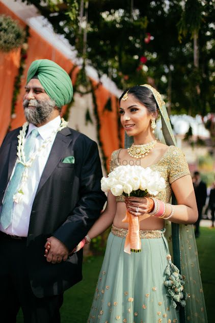 Photo of Bride entering wedding with her father