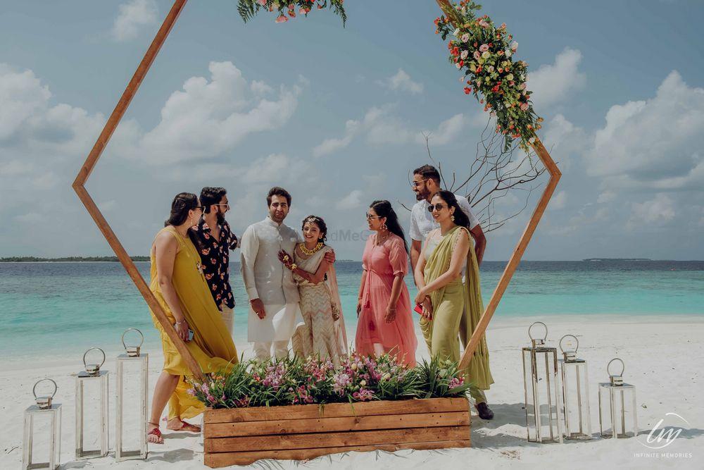 Photo of beach mehendi decor idea with photobooth