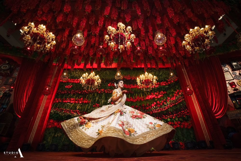 Photo of Birde twirling in floral sabyasachi lehenga