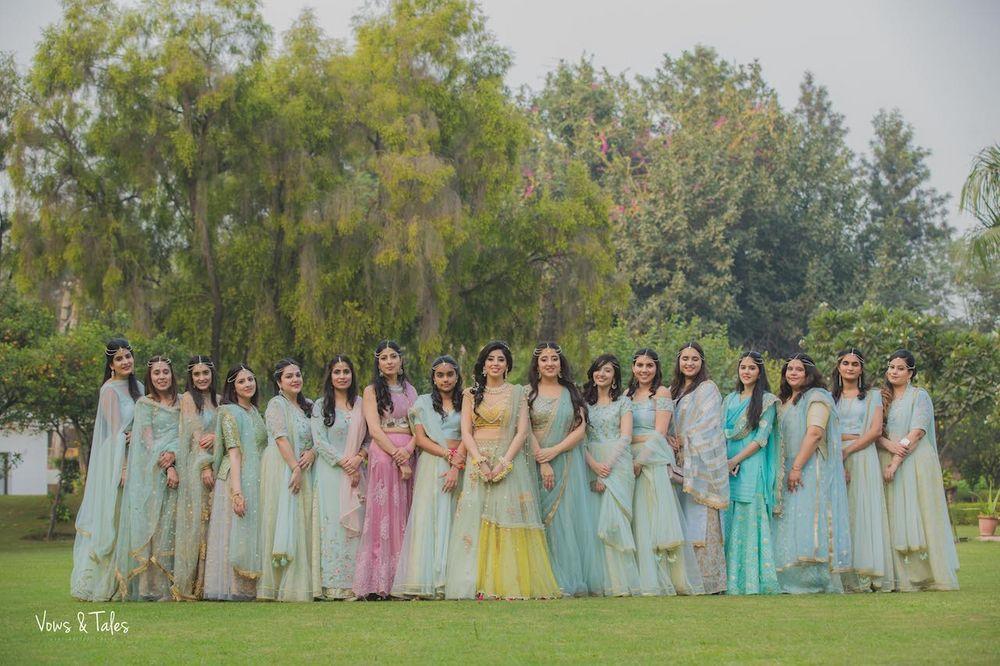 Photo of Matching pastel bride and bridesmaids