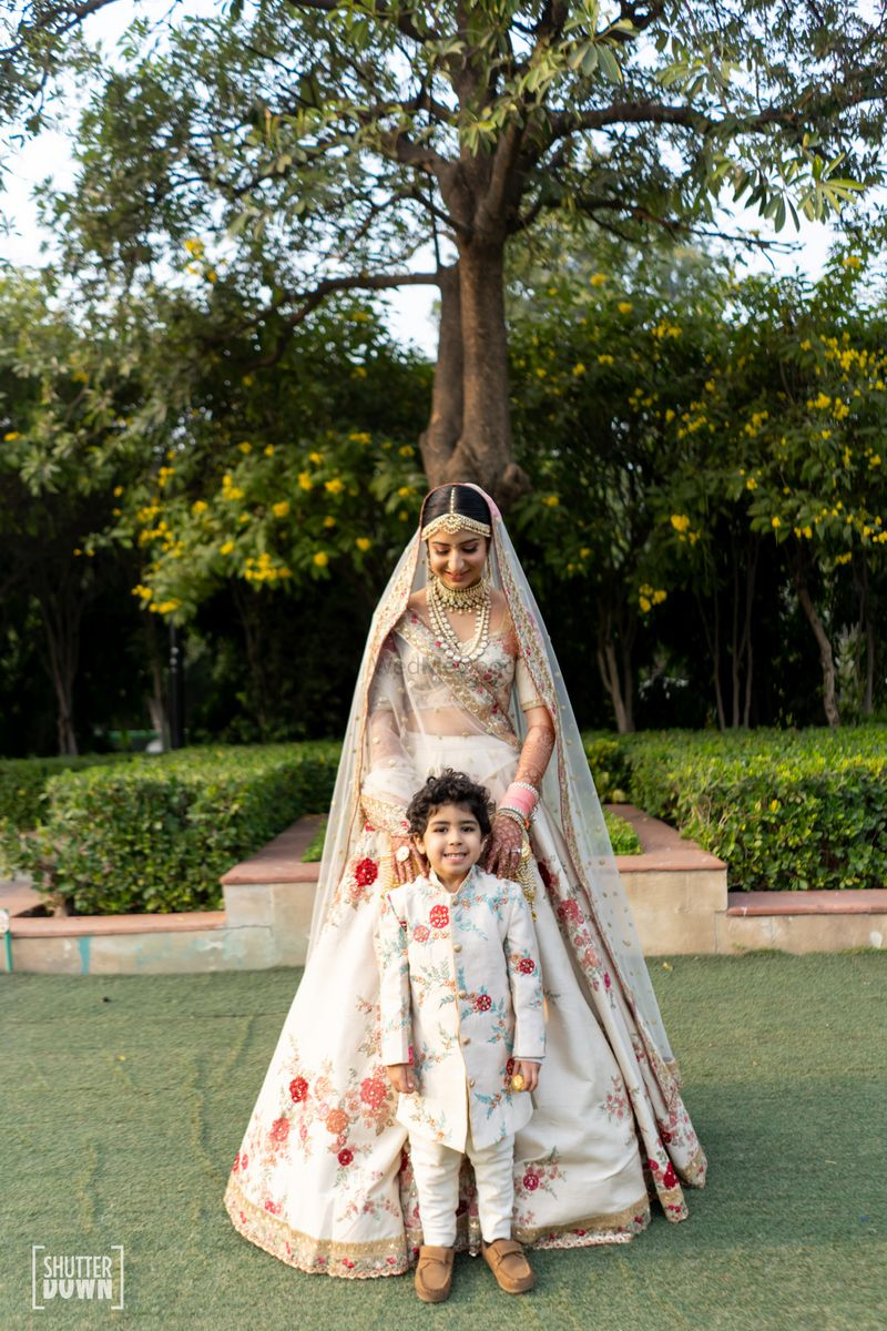 Photo of Bride with kid nephew matching her outfit