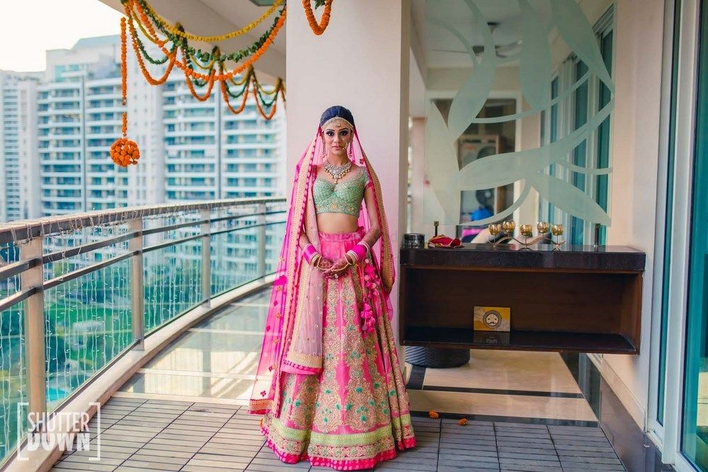 Photo of Mint and bright pink bridal lehenga