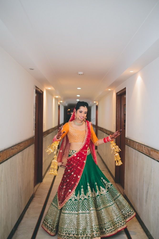 Photo of Colorblocked bridal lehenga in red green and yellow
