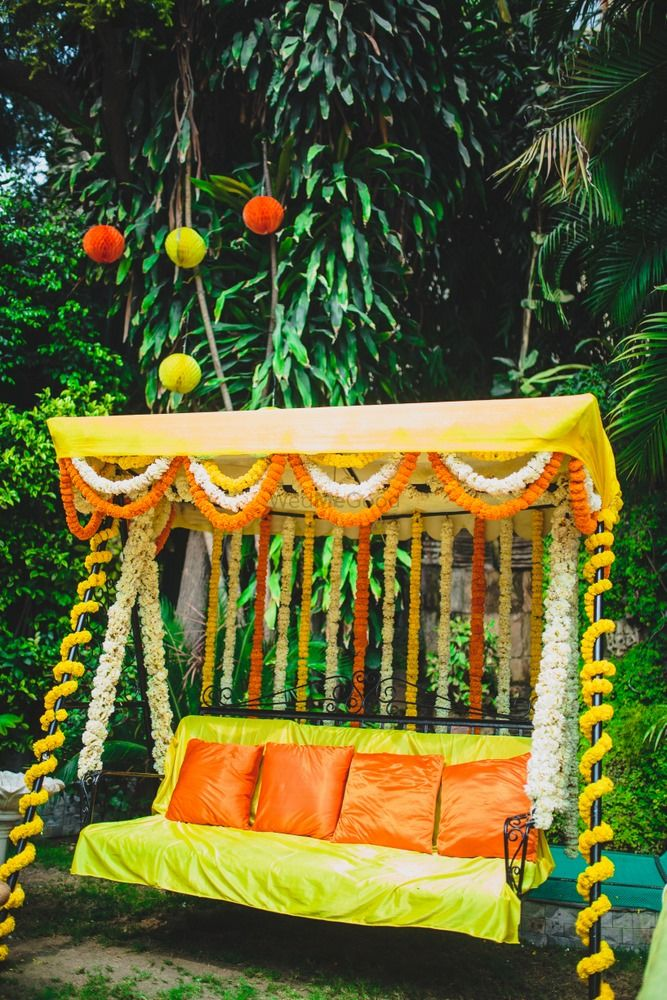 Photo of Floral swing with cushions for mehendi