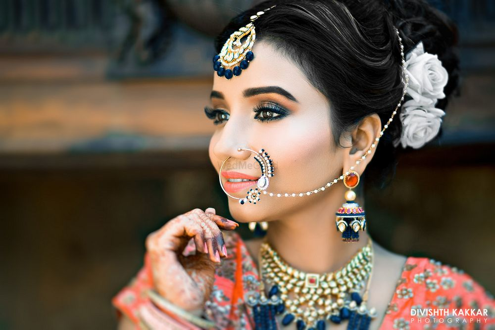 Photo of Classic bridal portrait with bride wearing silver Nath
