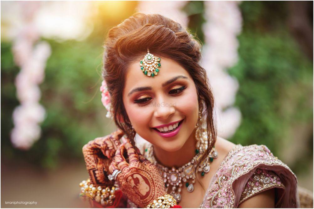 Photo of A cute bridal getting ready portrait