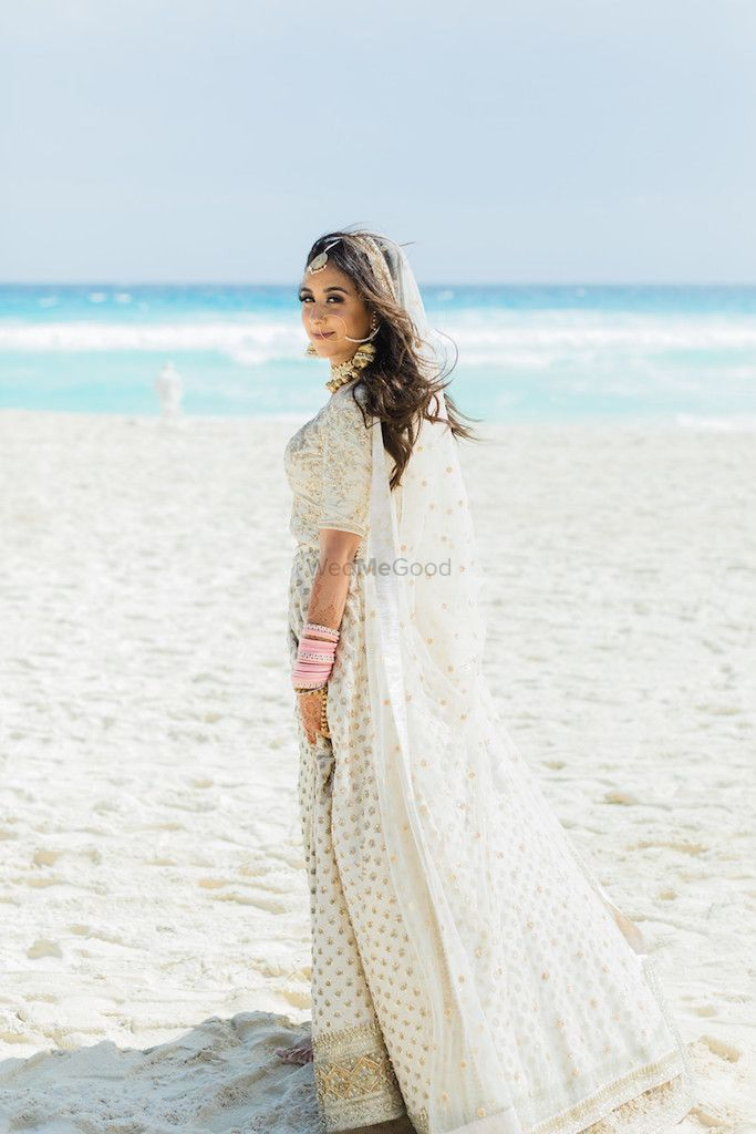 Photo of Beach wedding with bride in white