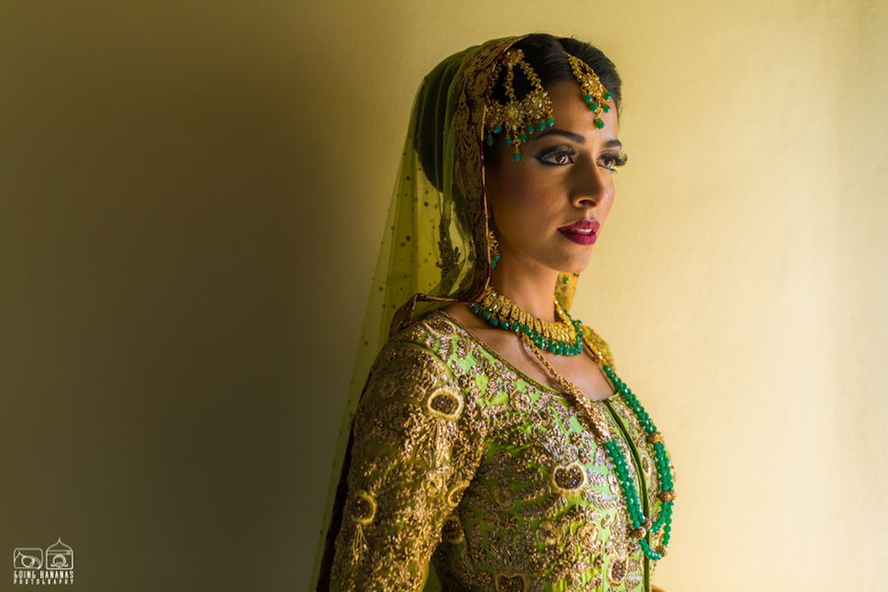 Photo of Offbeat bride in green lehenga and jewellery
