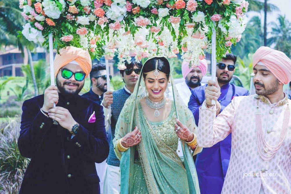 Photo of Bride entering with brothers