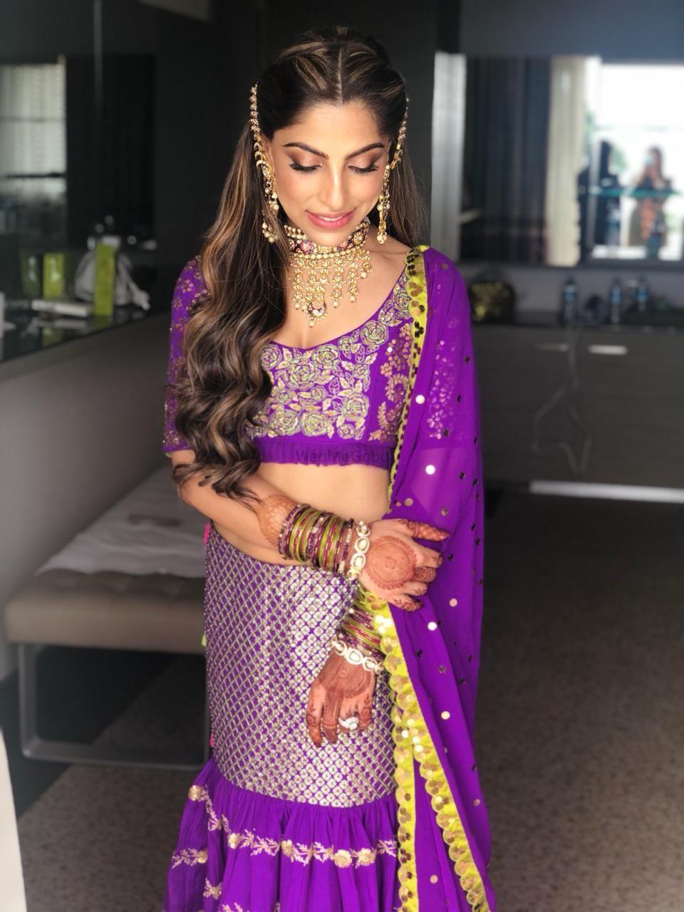 Photo of Mehendi bridal look in purple lehnga