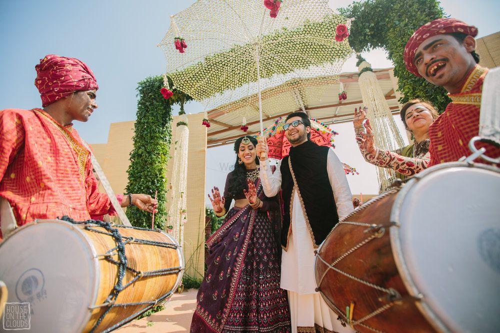 Unique Wedding Ideas Photo Bridal entry with a floral umbrella