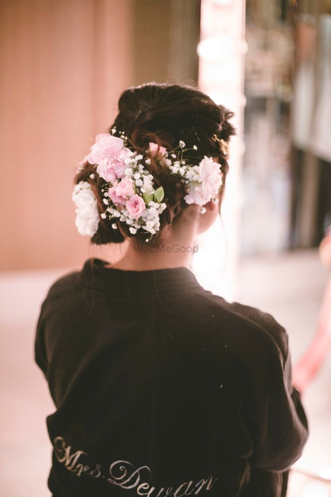 Photo of Bridal bun with flowers and babys breath