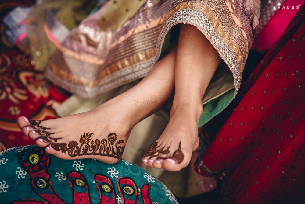 Photo of Unique and minimalistic feet mehndi design.
