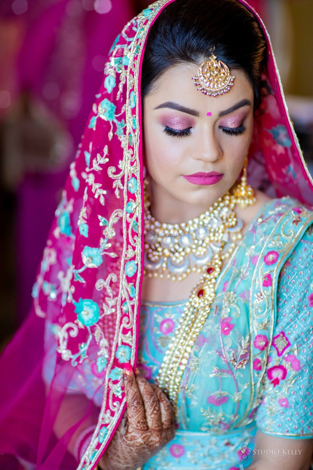 Photo of bride with light pink makeup and enamel jewellery