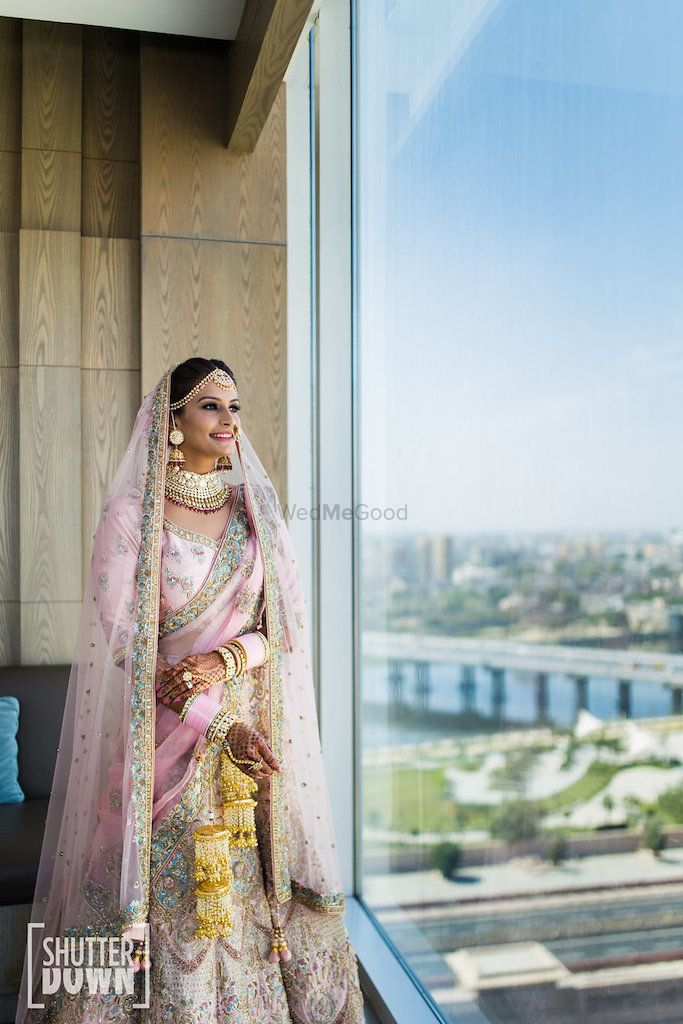 Photo of Bridal portrait by the window