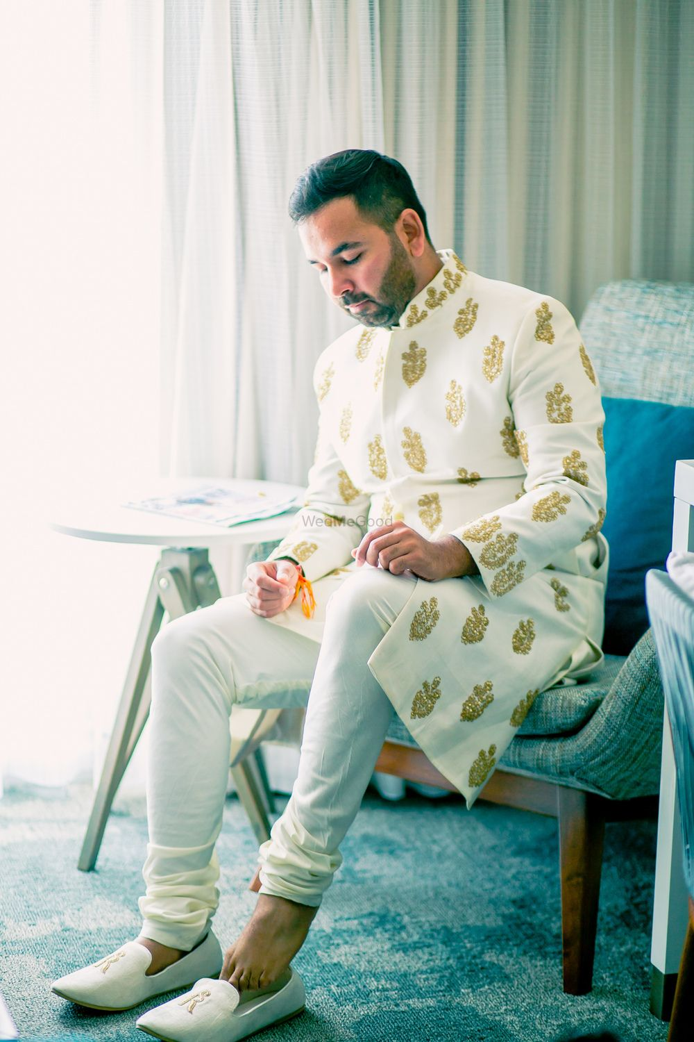 Photo of Groom in gold and white sherwani with buti design
