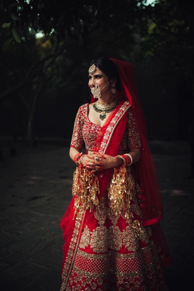 Photo of Bridal portrait of bride in red
