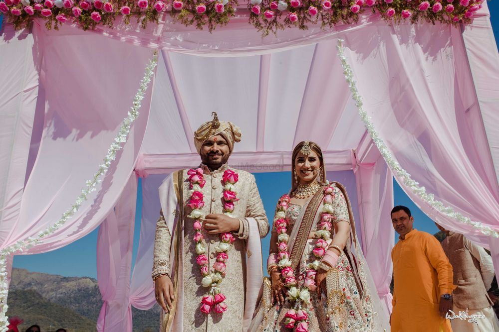 Photo of matching bride and groom after wedding in their jaimalas