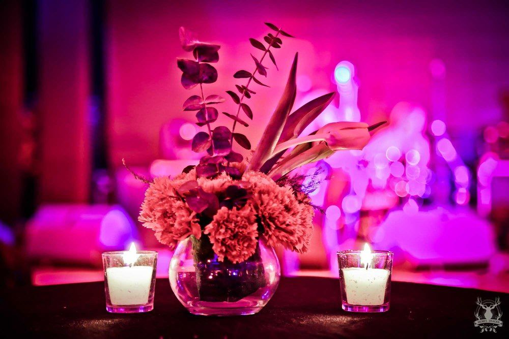 Photo of Table Centrepiece with Floral Arrangement and Candles
