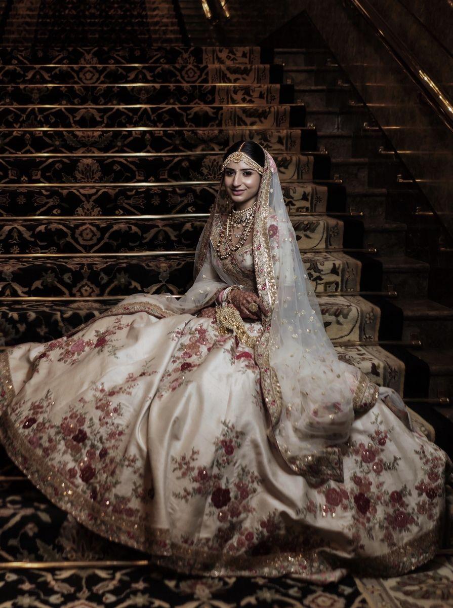 Photo of Wedding day bridal portrait in floral print sabya lehenga