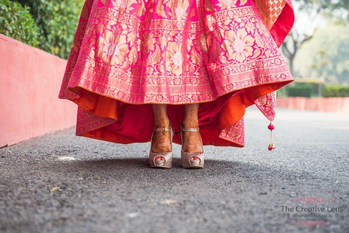 Photo of Pink banarsi bridal lehenga with silver peeptoe shoes