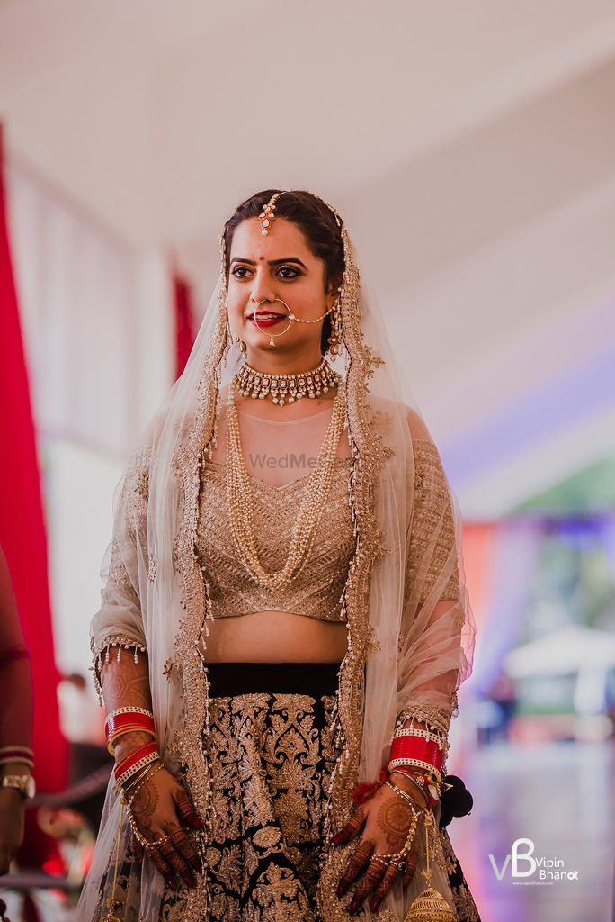 Photo of Bridal look in gold and maroon lehenga