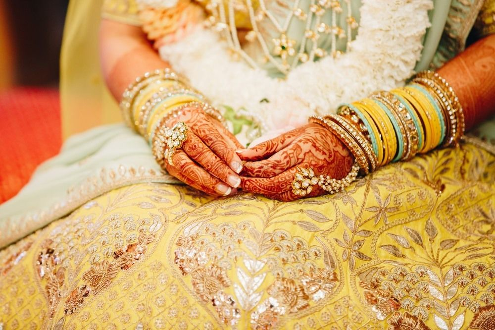 Photo of Bridal hands on yellow gota patti lehenga
