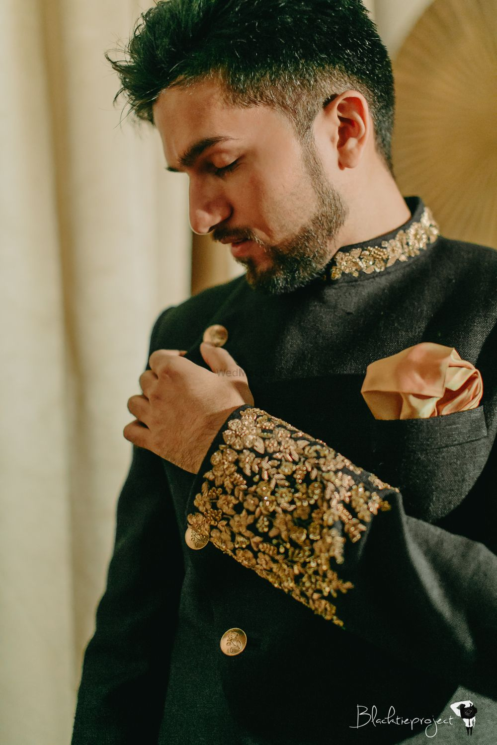 Photo of Black sherwani with gold embroidery on sleeves
