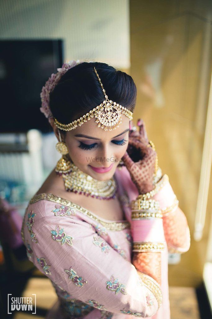 Photo of Bride getting ready shot wearing jewellery