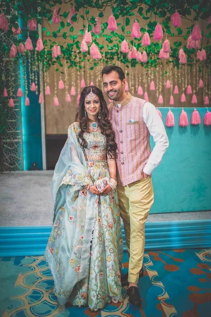 Photo of Bride in blue outfit with her groom