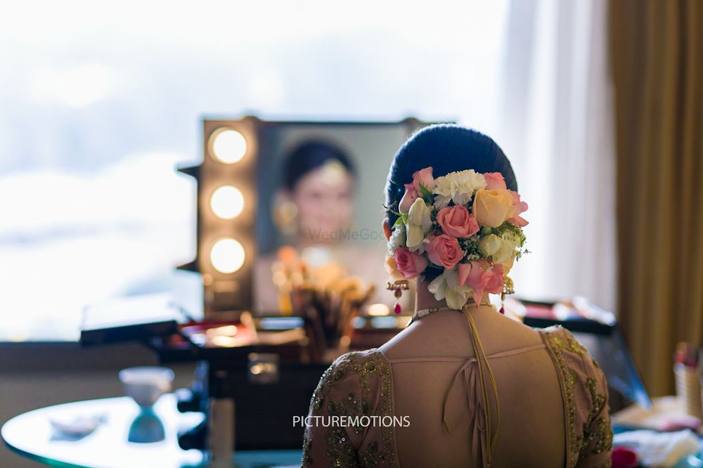 Photo of Bridal bun with colourful roses