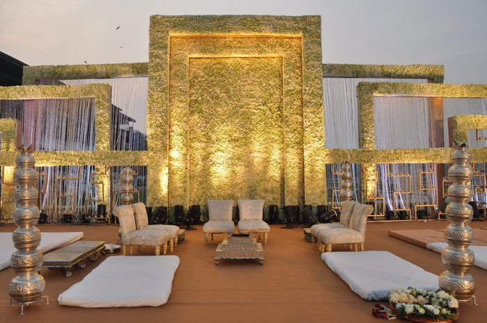 Photo of Stage decor in white with floral wall