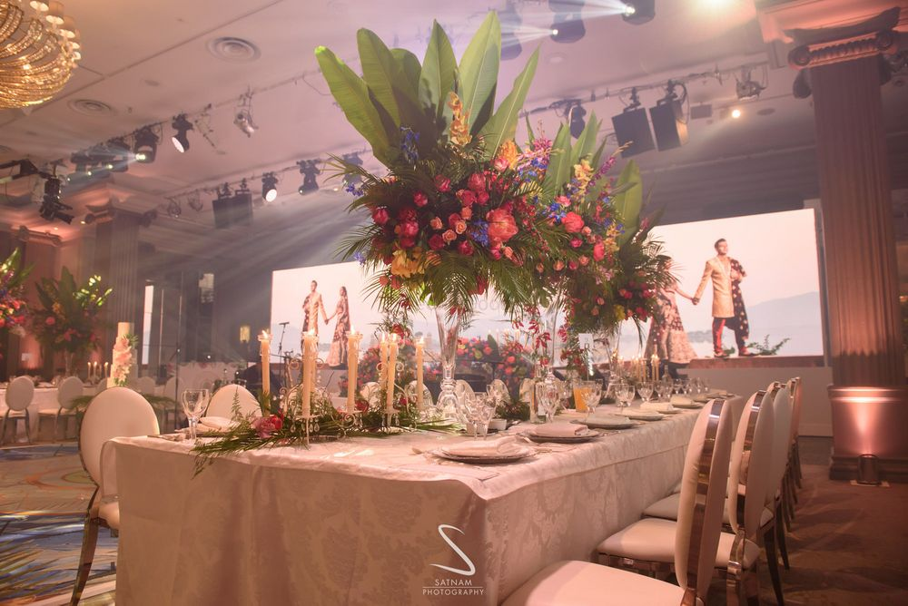 Photo of grand table centrepiece idea for reception