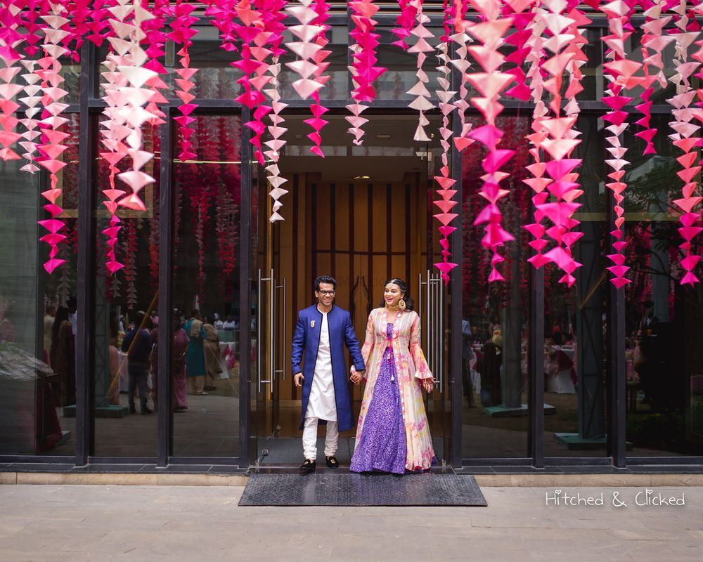 Photo of Suspended pink paper decor for mehendi