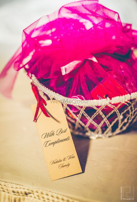 Photo of jewelled pink wedding favors with net covering.