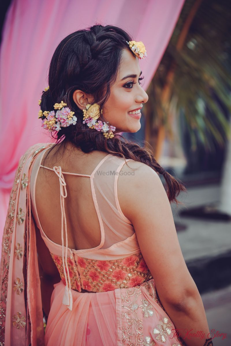 Photo of Mehendi look with floral braided hair
