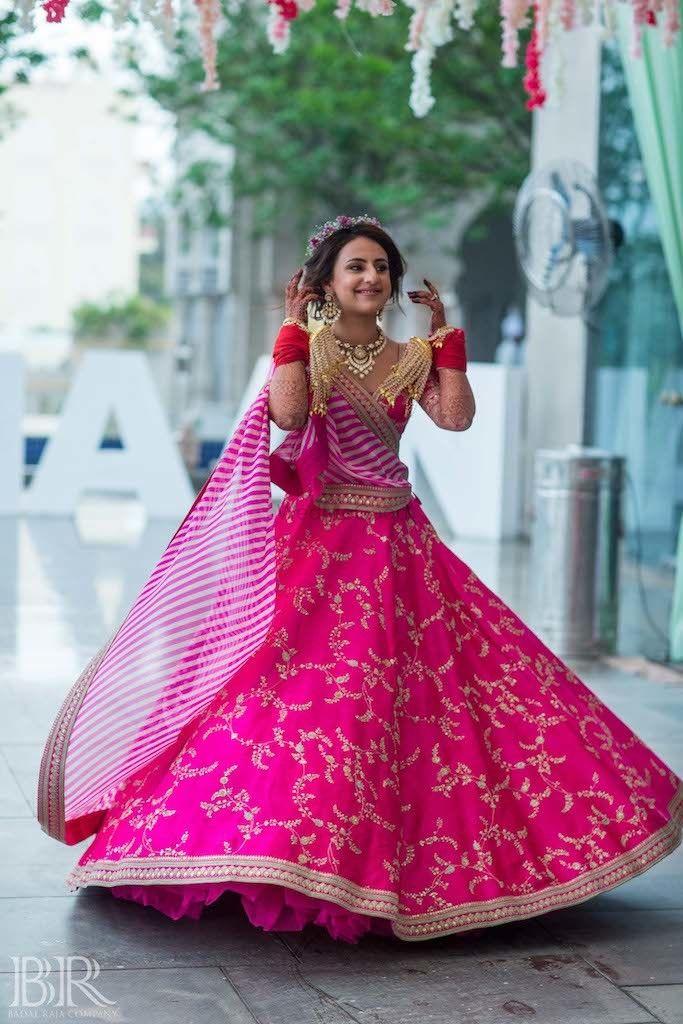 Photo of Bright pink sabysachi lehenga for mehendi