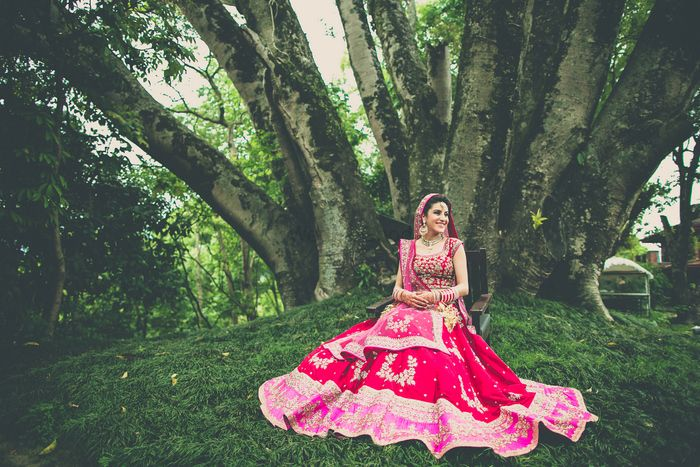 Photo of red and pink bridal lehenga