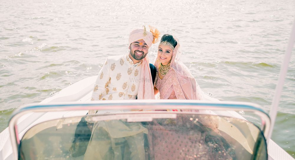 Photo of Couple entering idea on speedboat