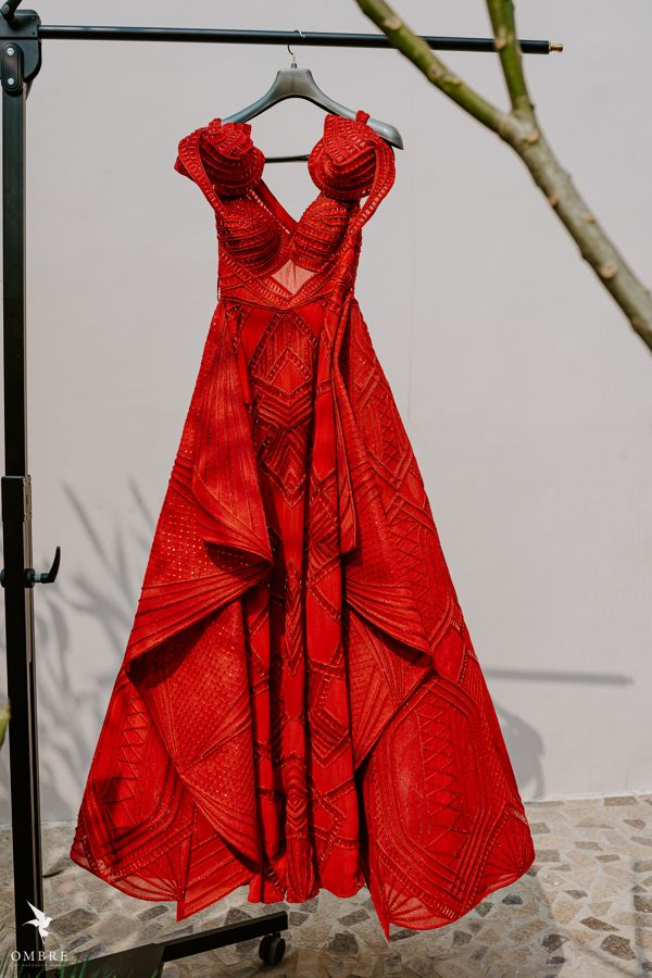Photo of Red reception gown for the bride