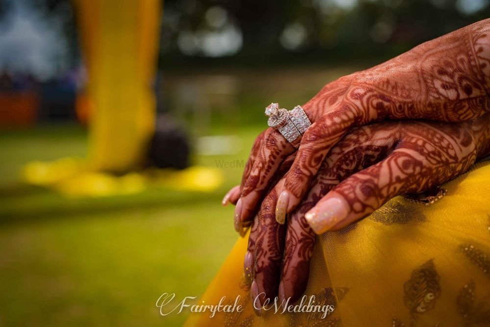 Photo of Solitaire engagement ring on mehendi hands
