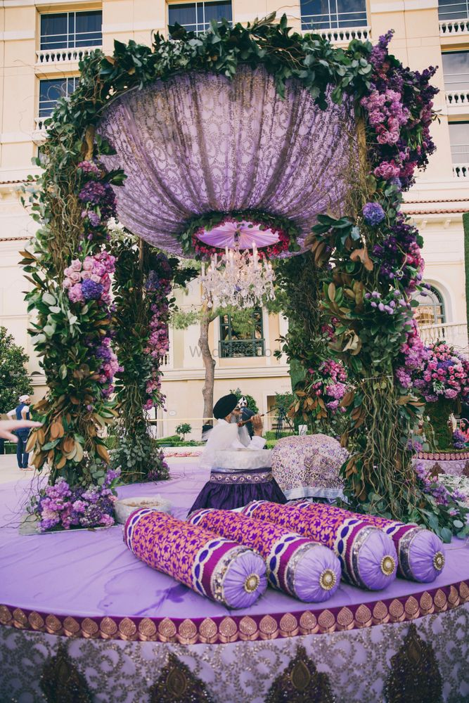 Photo of Purple and lavender mandap with chandelier