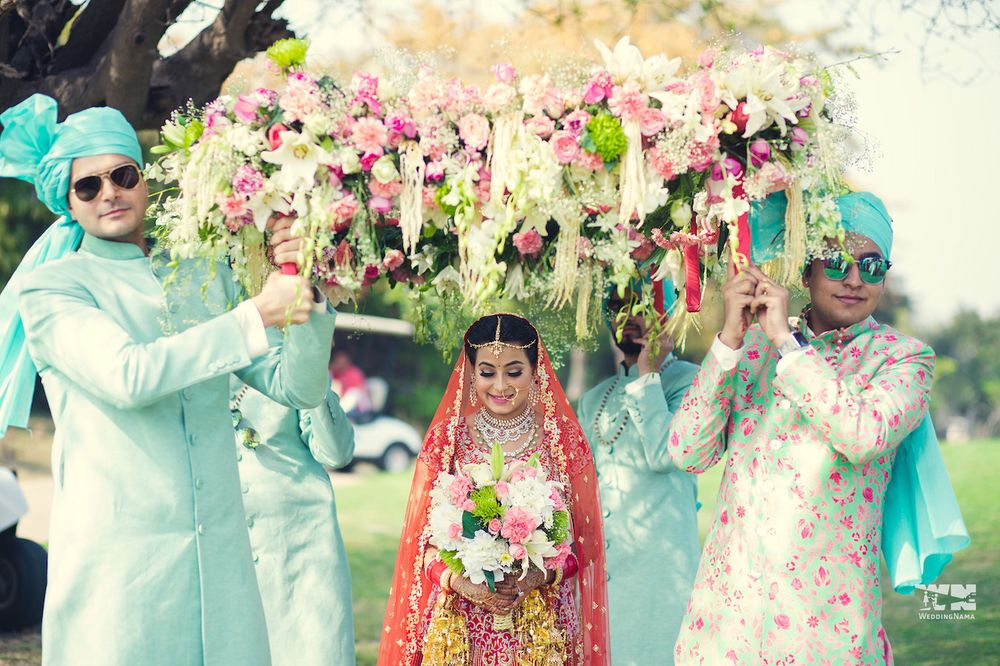 Photo of Bridal entry with matching brothers