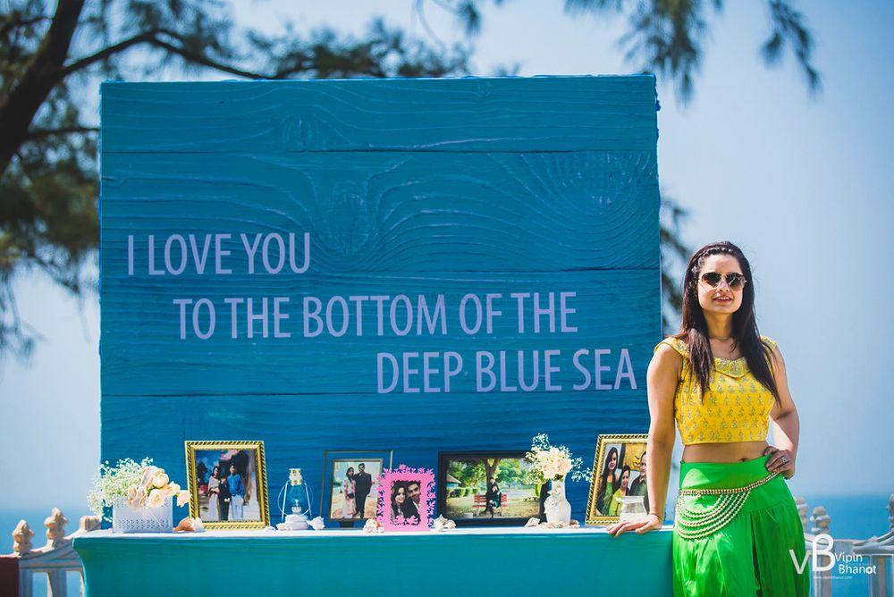 Photo of Beach wedding decor photobooth for mehendi