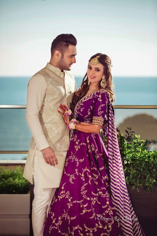 Photo of Mehendi portrait in purple Sabyasachi lehenga