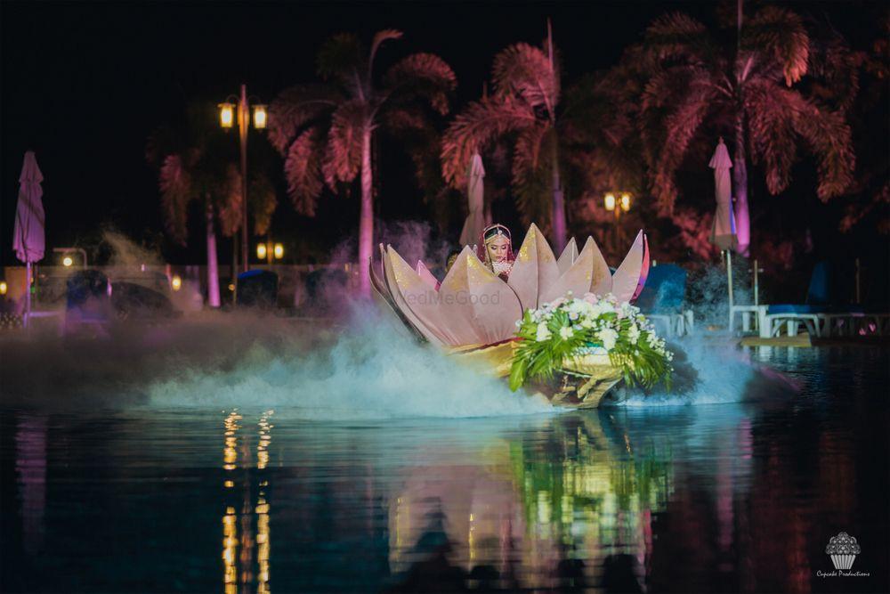 Photo of Unique bridal entry in lotus prop