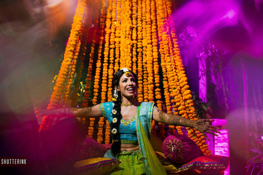 Photo of Happy bride on mehendi shot