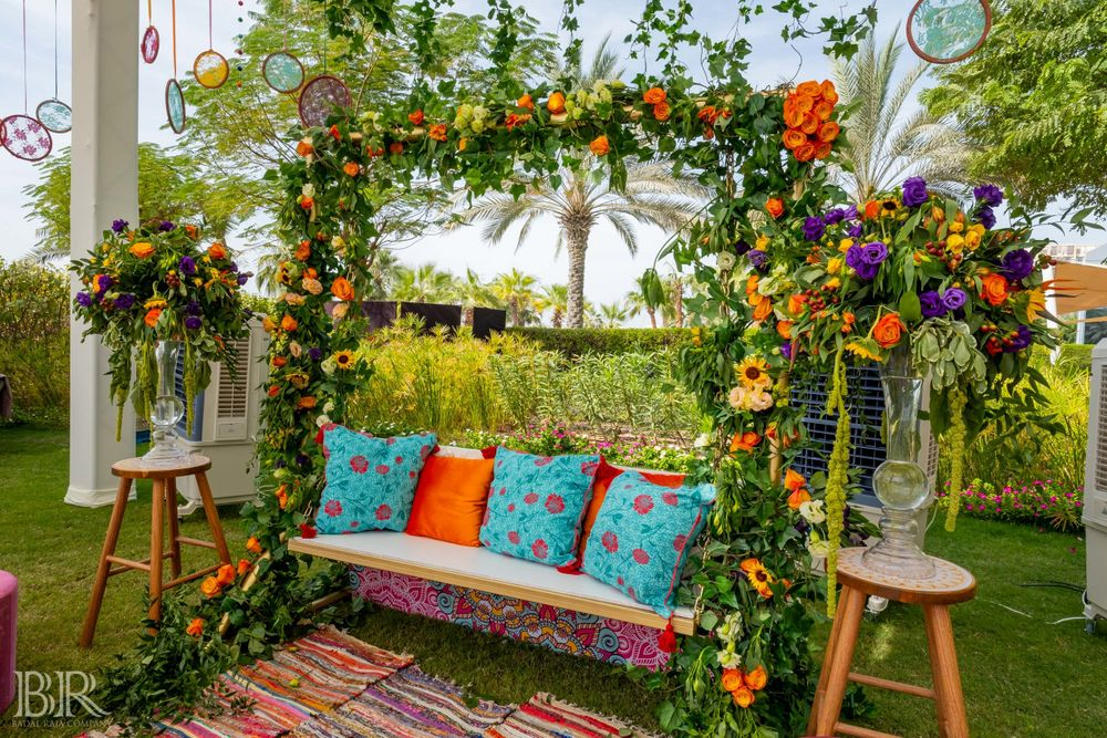 Photo of Mehendi decor with cushions on swing